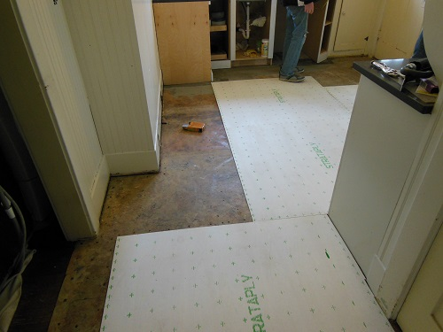 floor being covered by plywood