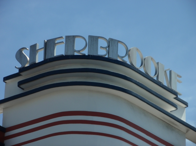 Detail of Sherbrooke sign in Broadway typeface atop hotel