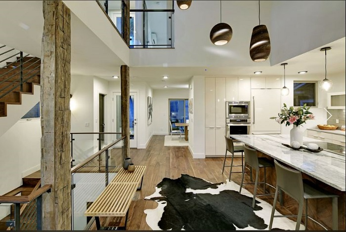 Modern open concept great room with cowhide rug