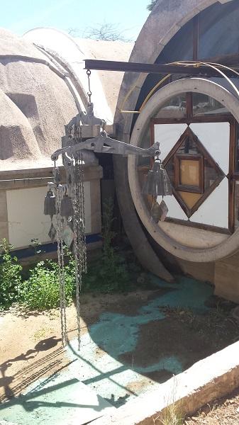 A large bell assemblage awaits restoration at Cosanti.