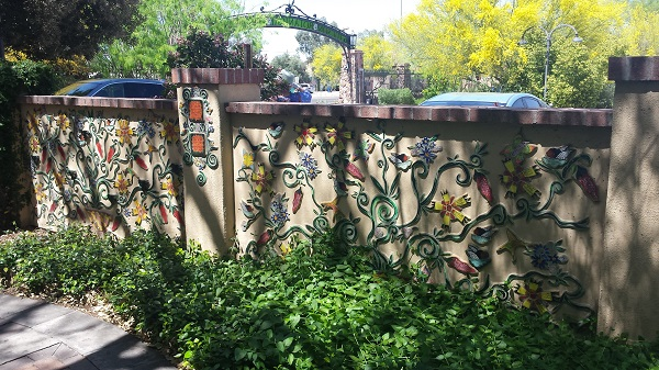 Wall with colorful ceramic appliques at Tucson Botanical Gardens.